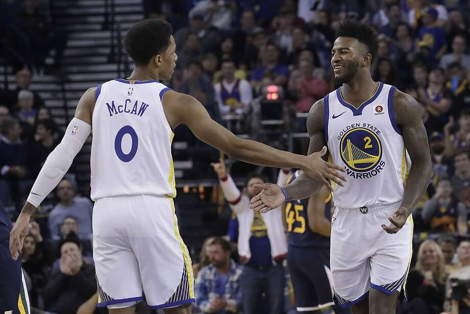 Golden State Warriors guard Patrick McCaw (0) and forward Jordan Bell (2) celebrate during the second half of an NBA basketball game against the Utah Jazz in Oakland, Calif., Wednesday, Dec. 27, 2017. (AP Photo/Jeff Chiu) Photo: Jeff Chiu, Associated Press