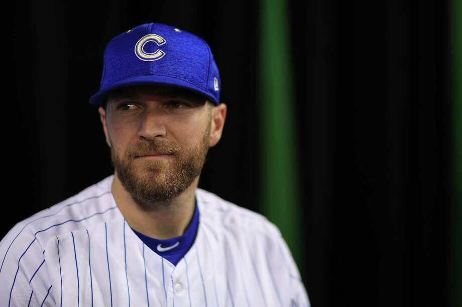 MIAMI, FL - JULY 10:  Wade Davis #71 of the Chicago Cubs and the National League speaks with the media during Gatorade All-Star Workout Day ahead of the 88th MLB All-Star Game at Marlins Park on July 10, 2017 in Miami, Florida.  (Photo by Mike Ehrmann/Getty Images) ORG XMIT: 700041421 Photo: Mike Ehrmann / 2017 Getty Images