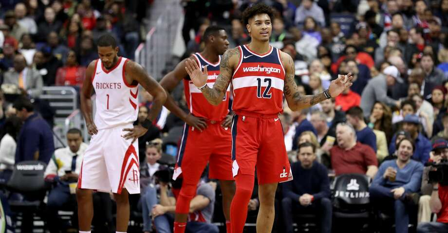 WASHINGTON, DC - DECEMBER 29: Kelly Oubre Jr. #12 of the Washington Wizards reacts after being called for a technical foul against the Houston Rockets in the first half at Capital One Arena on December 29, 2017 in Washington, DC. NOTE TO USER: User expressly acknowledges and agrees that, by downloading and or using this photograph, User is consenting to the terms and conditions of the Getty Images License Agreement. (Photo by Rob Carr/Getty Images) Photo: Rob Carr/Getty Images