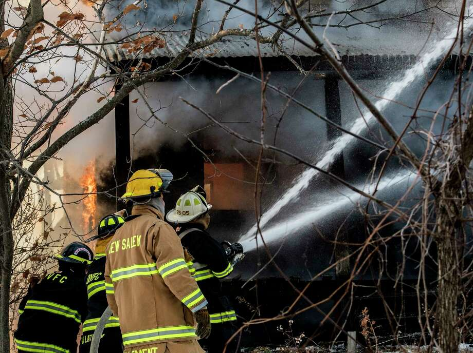 A multi-alarm fire consumes the structure at 492 Font Grove Road on Friday, Dec 29, 2017, in Bethlehem, N.Y.  (Skip Dickstein/ Times Union) Photo: SKIP DICKSTEIN