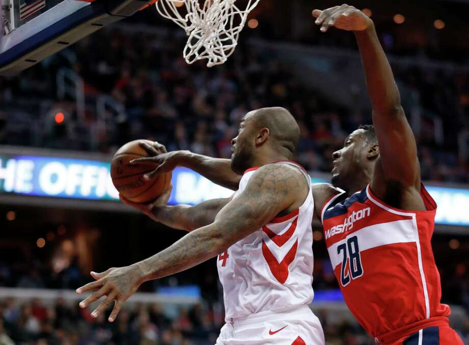 Houston Rockets forward PJ Tucker (4) shoots as Washington Wizards center Ian Mahinmi (28), from France, gets his hand on the ball during the first half of an NBA basketball game Friday, Dec. 29, 2017, in Washington. (AP Photo/Alex Brandon) Photo: Alex Brandon, STF / Copyright 2017 The Associated Press. All rights reserved.