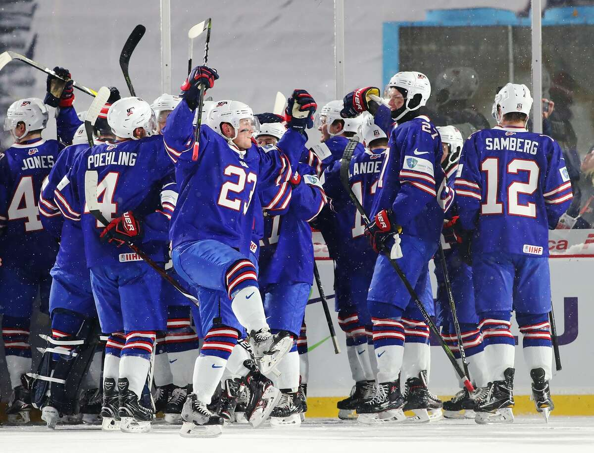 BUFFALO, NY - DECEMBER 29: The United States team celebrates after beating Canada during the IIHF World Junior Championship at New Era Field on December 29, 2017 in Buffalo, New York. The United States beat Canada 4-3. (Photo by Kevin Hoffman/Getty Images)