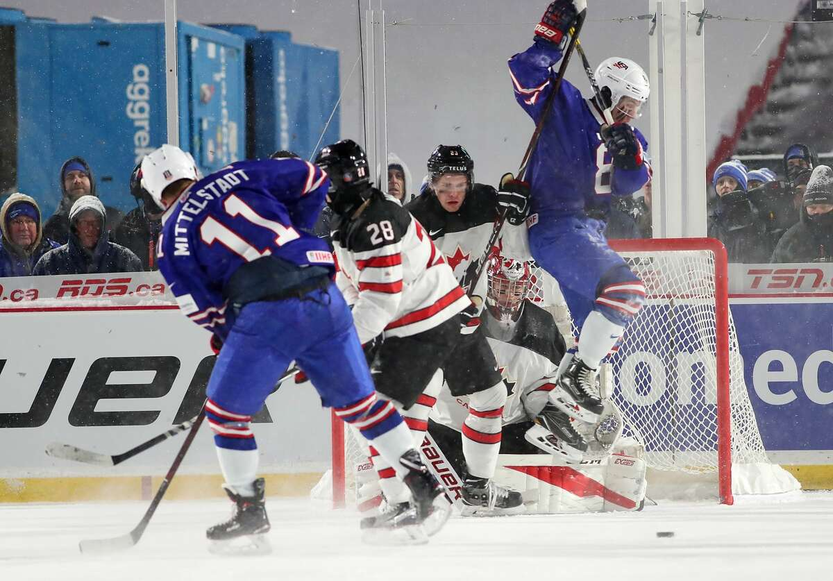 BUFFALO, NY - DECEMBER 29: Casey Mittelstadt #11 of United States takes a shot as Adam Fox #8 jumps to screen Carter Hart #31 of Canada during the IIHF World Junior Championship at New Era Field on December 29, 2017 in Buffalo, New York. The United States beat Canada 4-3. (Photo by Kevin Hoffman/Getty Images)