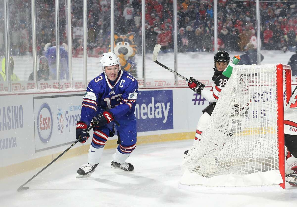 BUFFALO, NY - DECEMBER 29: Joey Anderson #13 of United States with the puck behind the net as Victor Mete #28 of Canada pursues during the IIHF World Junior Championship at New Era Field on December 29, 2017 in Buffalo, New York. The United States beat Canada 4-3. (Photo by Kevin Hoffman/Getty Images)