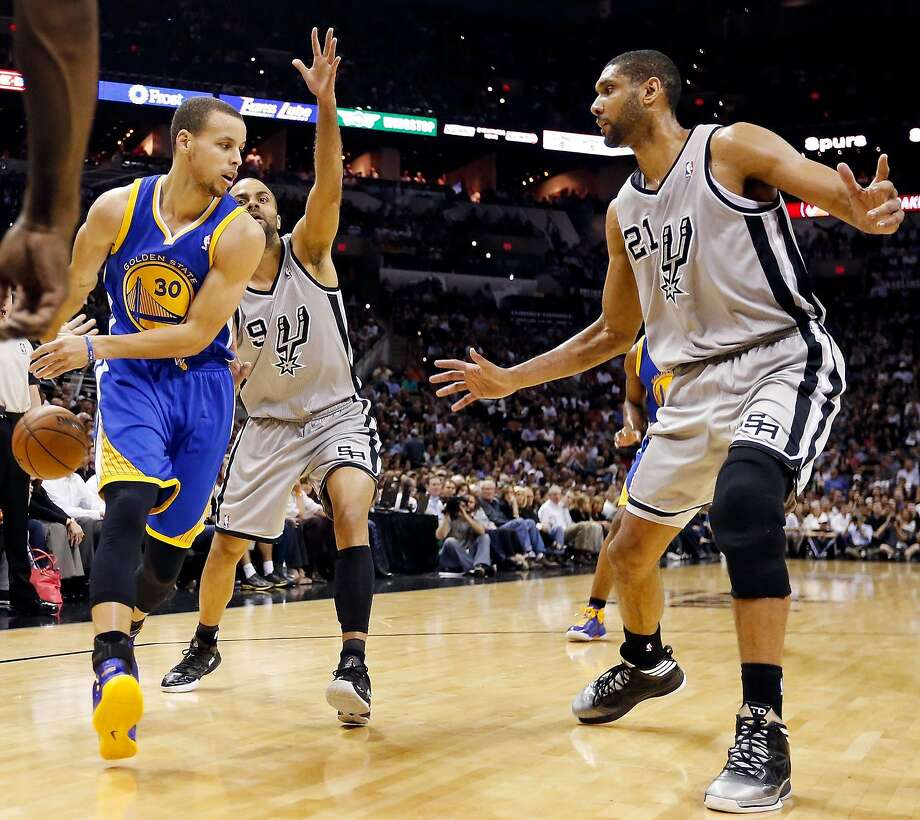 Golden State Warriors' Stephen Curry pass around San Antonio Spurs' Tony Parker and San Antonio Spurs' Tim Duncan during first half action of Game 5 in the NBA Western Conference semifinals Tuesday May 14, 2013 at the AT&T Center. Photo: Edward A. Ornelas, San Antonio Express-News