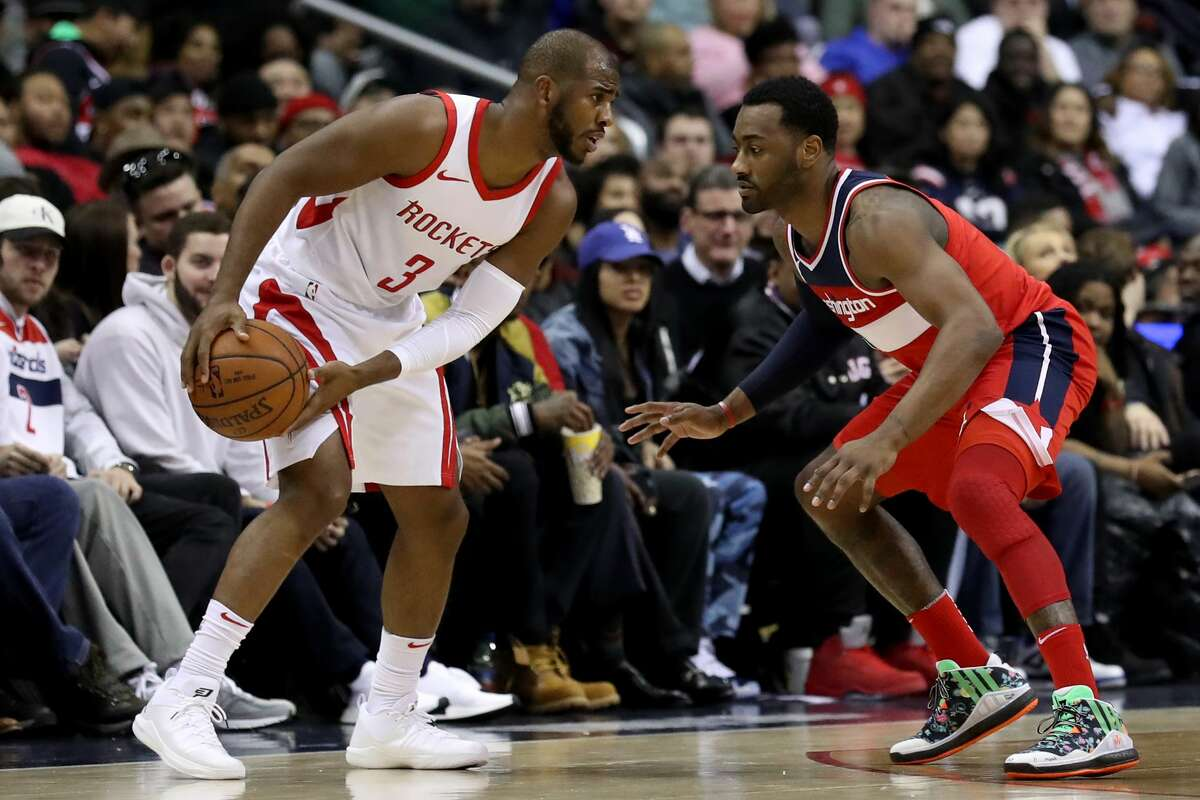 WASHINGTON, DC - DECEMBER 29: Chris Paul #3 of the Houston Rockets works the ball against John Wall #2 of the Washington Wizards in the second half at Capital One Arena on December 29, 2017 in Washington, DC. NOTE TO USER: User expressly acknowledges and agrees that, by downloading and or using this photograph, User is consenting to the terms and conditions of the Getty Images License Agreement. (Photo by Rob Carr/Getty Images)
