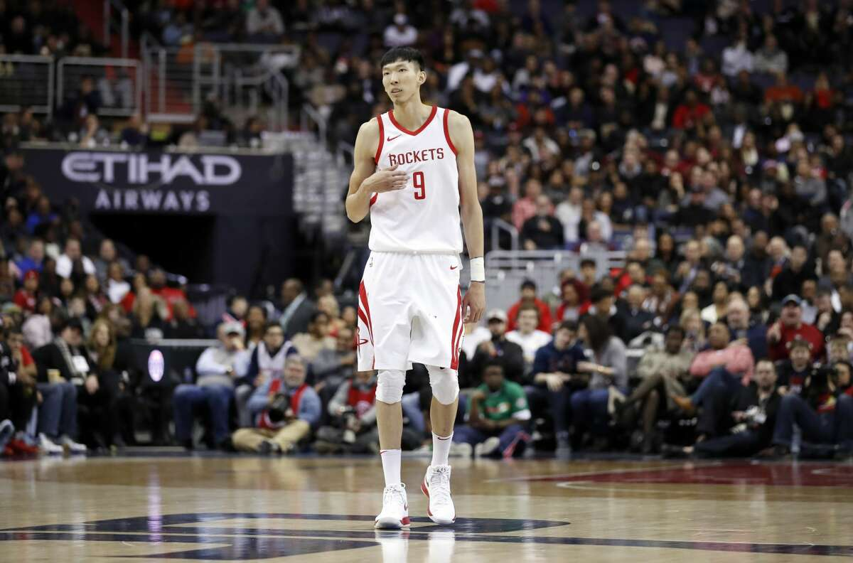 Houston Rockets forward Zhou Qi (9) stands on the court during the first half of an NBA basketball game against the Washington Wizards, Friday, Dec. 29, 2017, in Washington. (AP Photo/Alex Brandon)