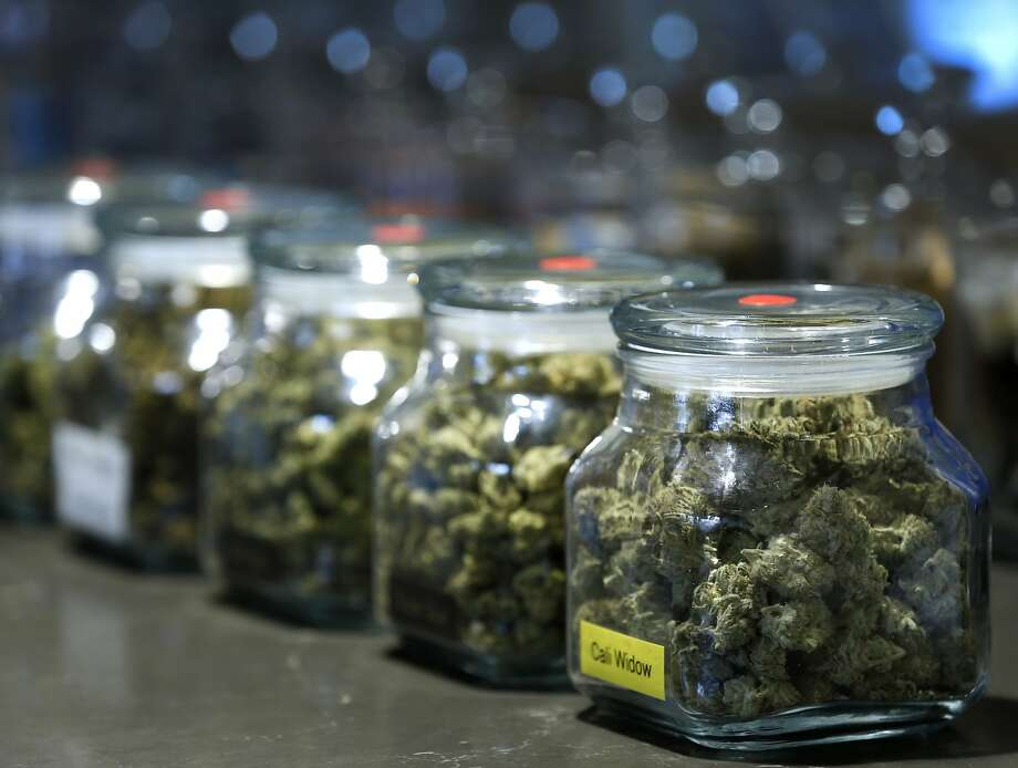 Jars of medicinal marijuana are displayed at the Apothecarium dispensary on Market Street in San Francisco. Photo: Paul Chinn, The Chronicle
