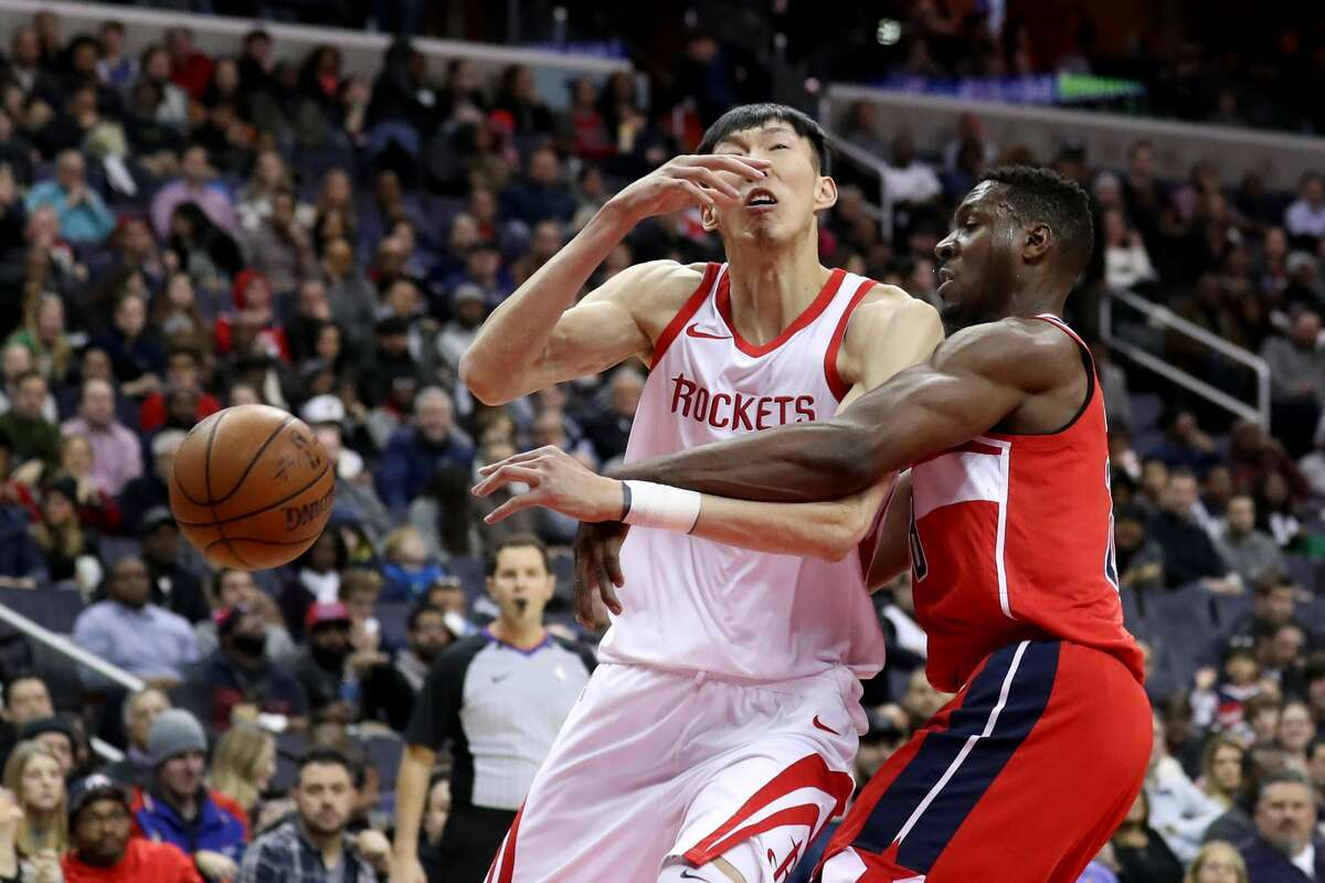 WASHINGTON, DC - DECEMBER 29: Ian Mahinmi #28 of the Washington Wizards fouls Zhou Qi #9 of the Houston Rockets in the first half at Capital One Arena on December 29, 2017 in Washington, DC. NOTE TO USER: User expressly acknowledges and agrees that, by downloading and or using this photograph, User is consenting to the terms and conditions of the Getty Images License Agreement. (Photo by Rob Carr/Getty Images)