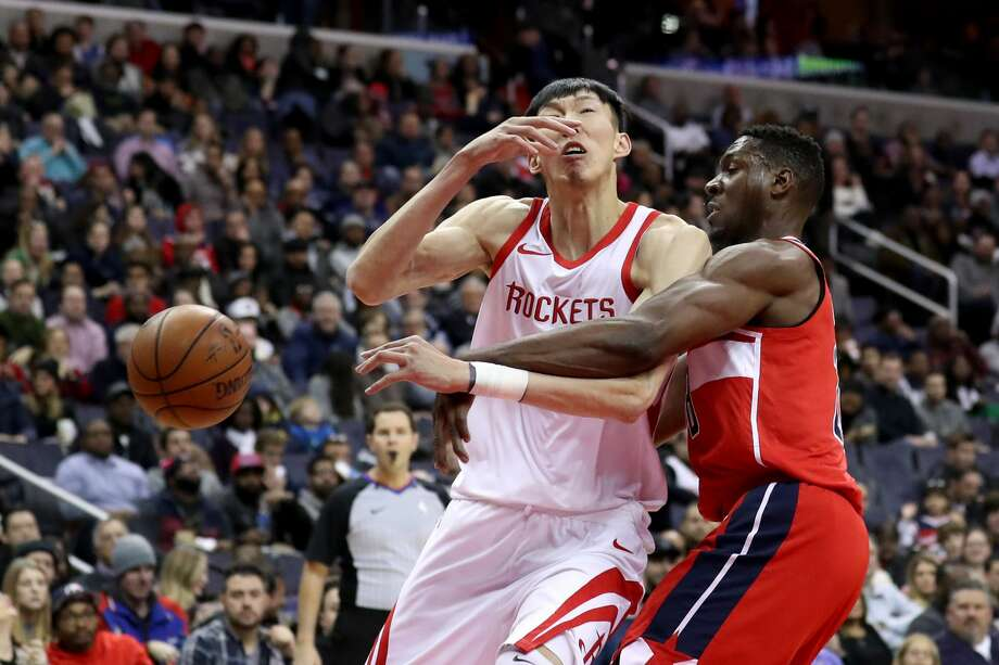 WASHINGTON, DC - DECEMBER 29: Ian Mahinmi #28 of the Washington Wizards fouls Zhou Qi #9 of the Houston Rockets in the first half at Capital One Arena on December 29, 2017 in Washington, DC. NOTE TO USER: User expressly acknowledges and agrees that, by downloading and or using this photograph, User is consenting to the terms and conditions of the Getty Images License Agreement. (Photo by Rob Carr/Getty Images) Photo: Rob Carr/Getty Images