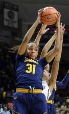 California's Kristine Anigwe (31) comes down with a rebound in the second half of the NCAA college basketball game against Connecticut Friday, November 17, 2017 at Gampel Pavilion in Storrs. The top ranked Connecticut women's basketball team hosted California in their home opener. Aging had a team-high 14 points. Connecticut won, 82-47. (AP Photo/Stephen Dunn)