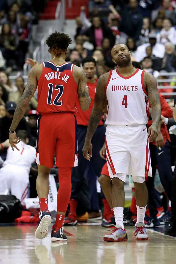 The Rockets' P.J. Tucker laments a 3-pointer by the Wizards, who hit half their 36 attempts to the Rockets' 29.2 percent. Photo: Rob Carr, Staff / 2017 Getty Images