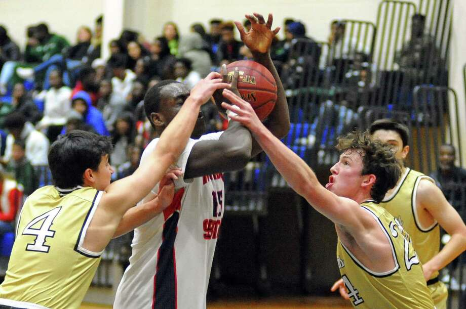 Joel Barlow's Owen Corazzelli, right, and James Menapace (4), block a shot attempt by Brien McMahon's Saikwon Williams, center, during holiday tournament basketball in Norwalk, Conn., on Friday Dec. 29, 2017. Photo: Christian Abraham / Hearst Connecticut Media / Connecticut Post