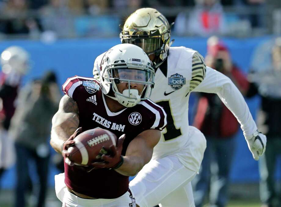 A&M's Christian Kirk, who's bound for the NFL draft, had 13 catches for 189 yards in his final game with the Aggies in Friday's Belk Bowl. Photo: Chuck Burton, STF / Copyright 2017 The Associated Press. All rights reserved.