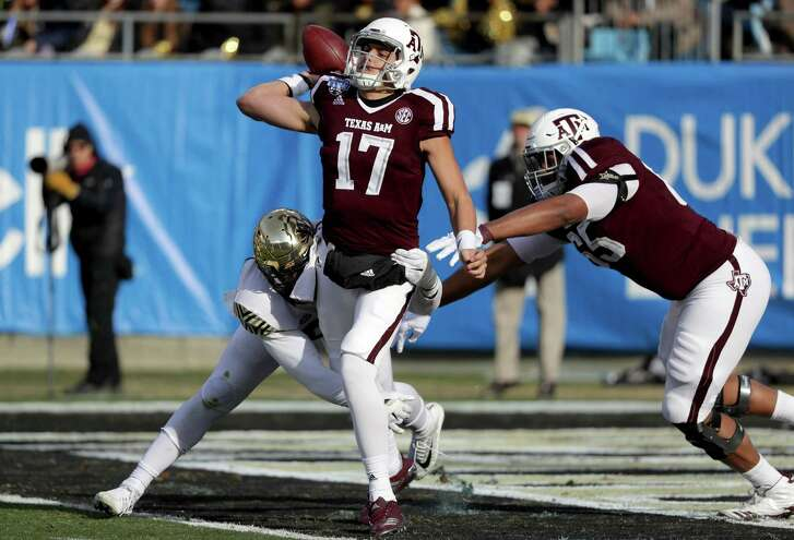 CHARLOTTE, NC - DECEMBER 29:  Nick Starkel #17 of the Texas A&M Aggies drops back to pass against the Wake Forest Demon Deacons during the Belk Bowl at Bank of America Stadium on December 29, 2017 in Charlotte, North Carolina.  (Photo by Streeter Lecka/Getty Images)
