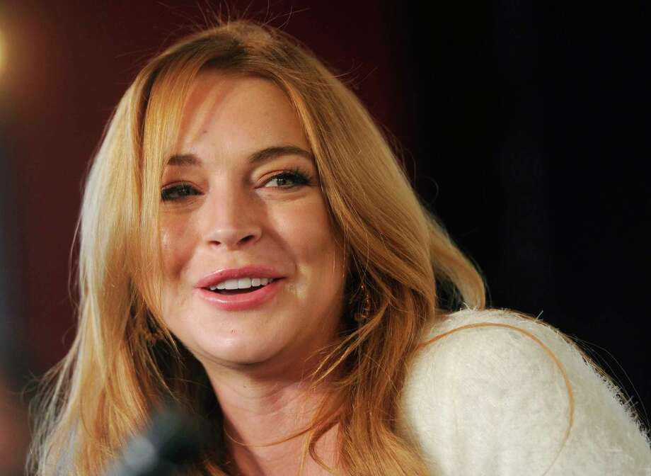 """FILE - In this Jan. 20, 2014 file photo, actress Lindsay Lohan addresses reporters during a news conference at the 2014 Sundance Film Festival in Park City, Utah. Lohan says she suffered a miscarriage during the taping of Sunday's final episode of her OWN cable channel reality TV series, """"Lindsay."""" (Photo by Chris Pizzello/Invision/AP, File) ORG XMIT: NY108 Photo: Chris Pizzello / Invision"""