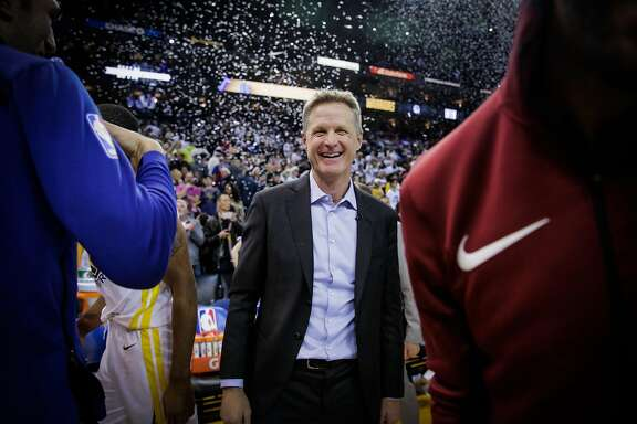 Golden State Warriors head coach Steve Kerr smiles after defeating the Cleveland Cavaliers in a game at Oracle Arena in Oakland, Calif., on Monday, Dec. 25, 2017.