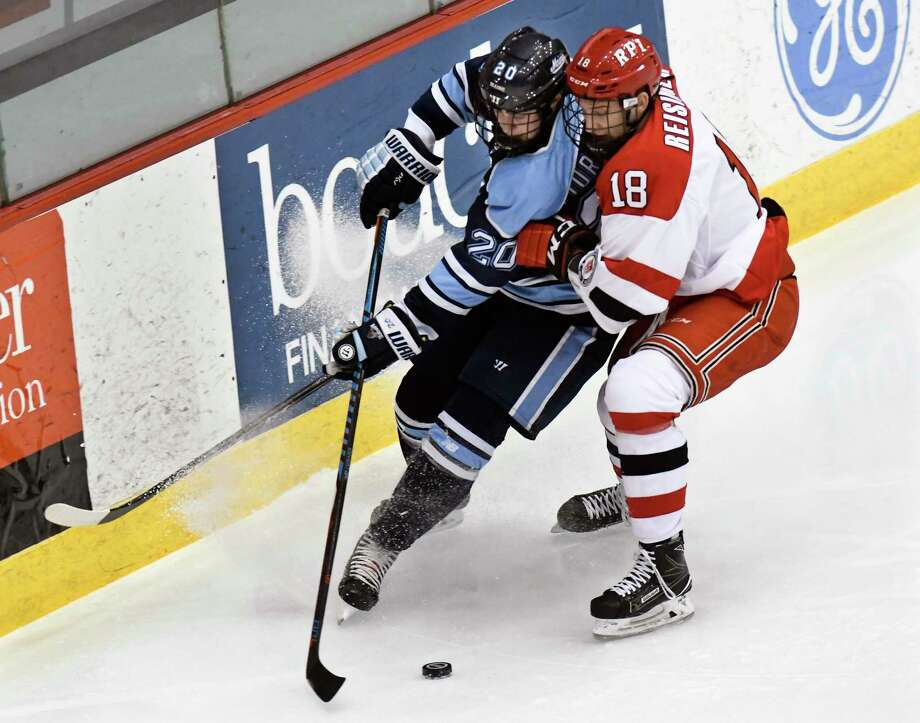Maine's defenseman Veli-Matti Tiuraniemi (20) and Rensselaer Polytechnic Institute's forward Max Reisinger (18) chase the puck during the first period of an NCAA college hockey game Friday, Dec. 29, 2017, in Troy, N.Y., (Hans Pennink / Special to the Times Union) Photo: Hans Pennink / Hans Pennink