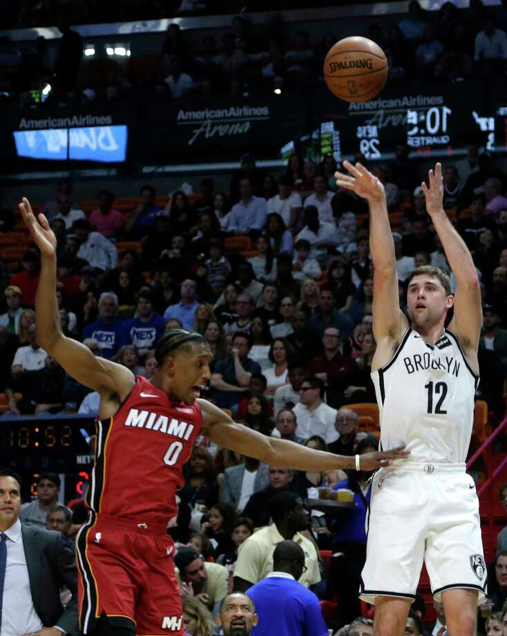 Brooklyn Nets' Joe Harris (12) is fouled by Miami Heat's Josh Richardson (0) while attempting a 3-point basket during the first half of an NBA basketball game Friday, Dec. 29, 2017, in Miami. (AP Photo/Lynne Sladky) Photo: Lynne Sladky / Copyright 2017 The Associated Press. All rights reserved.