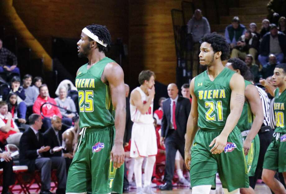 Nico Clareth, left, and Ahsante Shivers react to a play during Siena's 63-58 loss to Marist in their MAAC opener at McCann Center in Poughkeepsie on Friday, Dec. 29, 2017. (Courtesy of Marist Athletics)