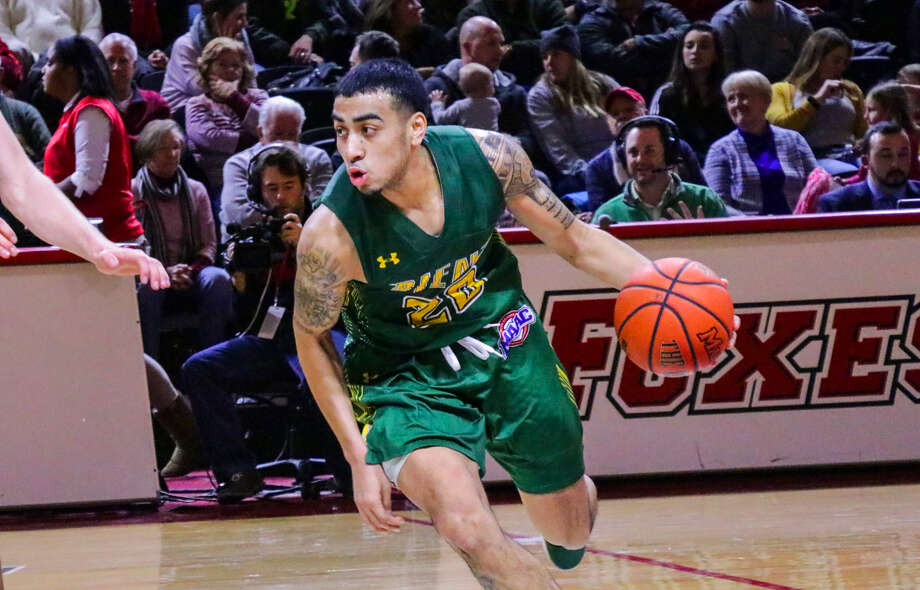 Siena's Roman Penn brings the ball up the court during their MAAC opener at McCann Center in Poughkeepsie on Friday, Dec. 29, 2017. Siena lost 63-58. (Courtesy of Marist Athletics)