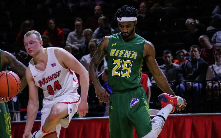Siena's Nico Clareth, right, and Marist's David Knudsen line up while awaiting a player to take free throws during their MAAC opener at McCann Center in Poughkeepsie on Friday, Dec. 29, 2017. Siena lost 63-58. (Courtesy of Marist Athletics)