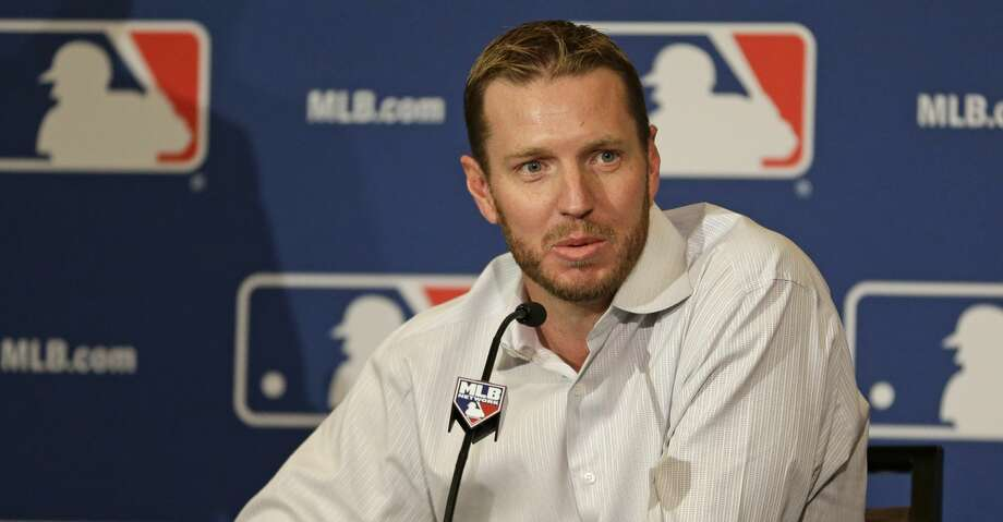 FILE - In this Dec. 9, 2013, file photo, two-time Cy Young Award winner Roy Halladay answers questions after announcing his retirement after 16 seasons in the major leagues with Toronto and Philadelphia at the Major League Baseball winter meetings in Lake Buena Vista, Fla. Halladay died in 2017, at age 40. (AP Photo/John Raoux, File) Photo: John Raoux/Associated Press