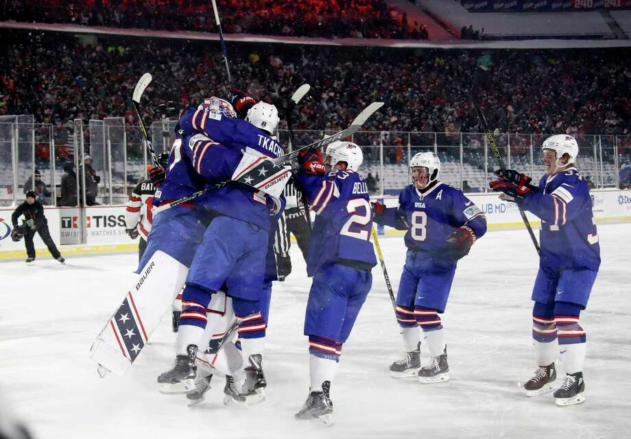 Players for the United States celebrate following the shootout period at their IIHF World Junior Championship preliminary round outdoor hockey game win against Canada at New Era Field in Orchard Park, N.Y., Friday, Dec. 29, 2017. (Mark Blinch/The Canadian Press via AP) Photo: Mark Blinch / CP