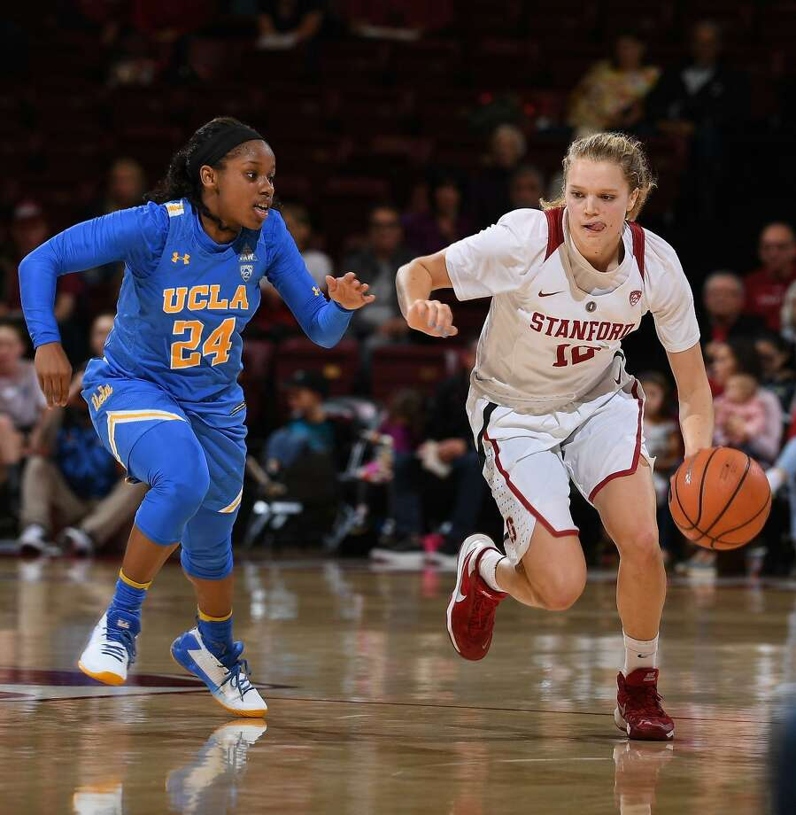 UCLA's Japreece Dean tries to slow Stanford's Brittany McPhee, whoi scored 13 in the fourth period as her team stretched a two-point lead into an 11-point win. Photo: Richard Ersted / ISIPhotos / Richard Ersted / ISIPhotos