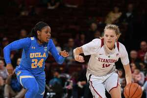 UCLA's Japreece Dean tries to slow Stanford's Brittany McPhee, whoi scored 13 in the fourth period as her team stretched a two-point lead into an 11-point win.