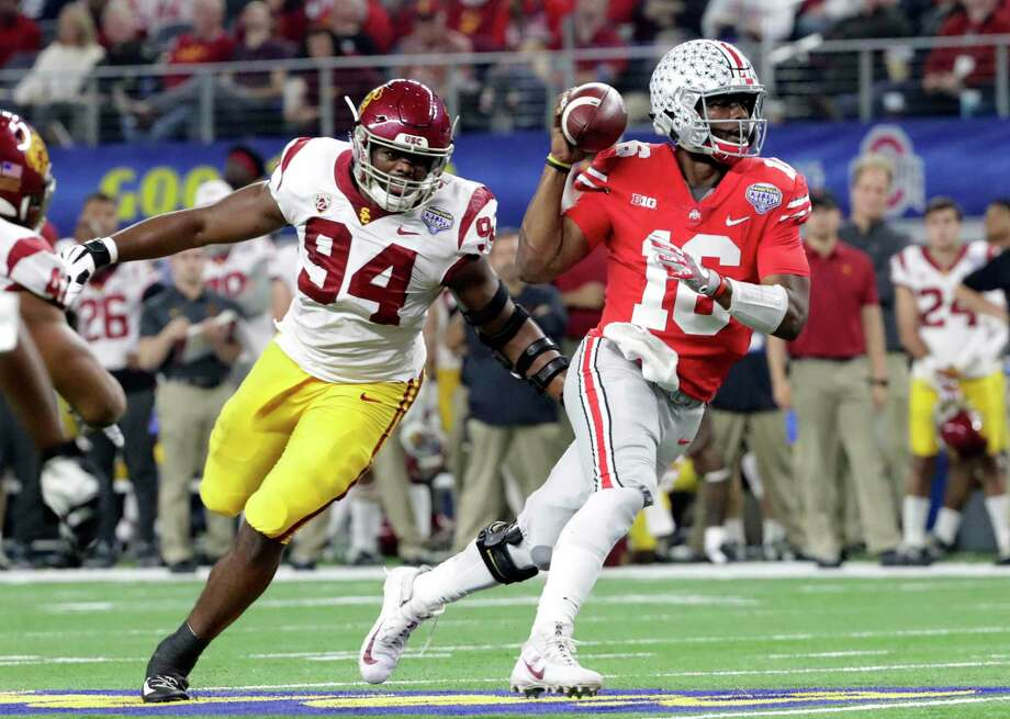 Ohio State quarterback J.T. Barrett (16) is chased by Southern California defensive tackle Rasheem Green (94) during the first half of the Cotton Bowl NCAA college football game in Arlington, Texas, Friday, Dec. 29, 2017. (AP Photo/LM Otero) Photo: LM Otero / Copyright 2017 The Associated Press. All rights reserved.