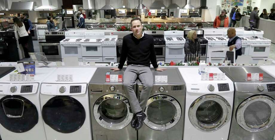 In this Wednesday, Dec. 20, 2017, photo, Jon Abt poses for a portrait on the sales floor of the Abt family's single appliance and furniture store in Glenview, Ill. Abt says his appliance and furniture store held its own this holiday season, up against competition like Amazon, Walmart, Best Buy and more, by capitalizing on advantages it has over the big guys. (AP Photo/Charles Rex Arbogast) Photo: Charles Rex Arbogast, STF / Copyright 2017 The Associated Press. All rights reserved.