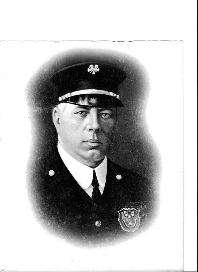 Fire Chief William P. Bishop, shown in this undated department portrait, died Dec. 31, 1917, when his chauffeur-driven car and an engine responding to the same alarm collided at the intersection of Commerce and Alamo streets, just outside Joske's department store. He had been fire chief since 1911. Photo: Courtesy / San Antonio Fire Museum