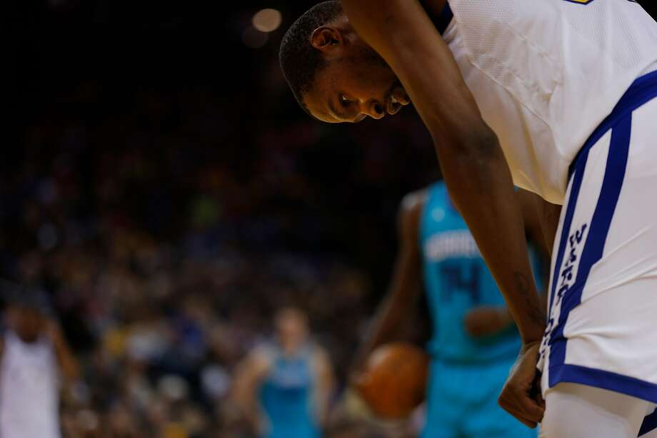 Things were not looking up for the Warriors and forward Kevin Durant in the second half of Friday's loss to the Hornets. Photo: Santiago Mejia, The Chronicle