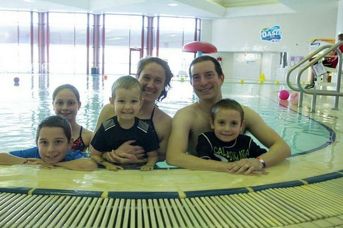 Wellness has become a way of life for the Jones family, which joined Greater Midland six years ago. Parents Tara and Travis Jones love to swim at the Community Center's Oasis Pool with their children, from left, Malachi, Nala, Kaemon and Levi. (Photo provided)