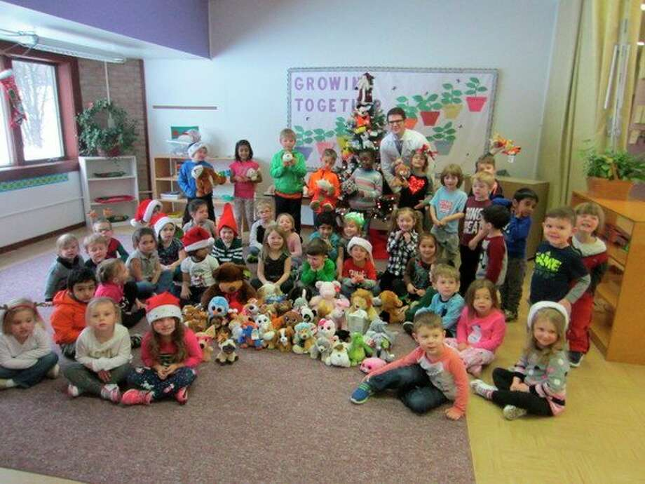 The children at Michele's Montessori School have been working hard this holiday season to collect new stuffed animals for children at MidMichigan Medical Center-Midland. These stuffed animals will be given to children to cuddle with while they are being cared for. Victor Hosfeld came to visit the children and spoke to them about the importance of making other children feel comfortable while in the hospital. (Photo provided)