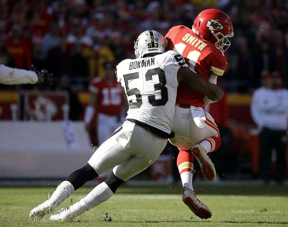 Oakland Raiders linebacker NaVorro Bowman (53) sacks Kansas City Chiefs quarterback Alex Smith (11) during the first half of an NFL football game in Kansas City, Mo., Sunday, Dec. 10, 2017. (AP Photo/Charlie Riedel) Photo: Charlie Riedel, Associated Press