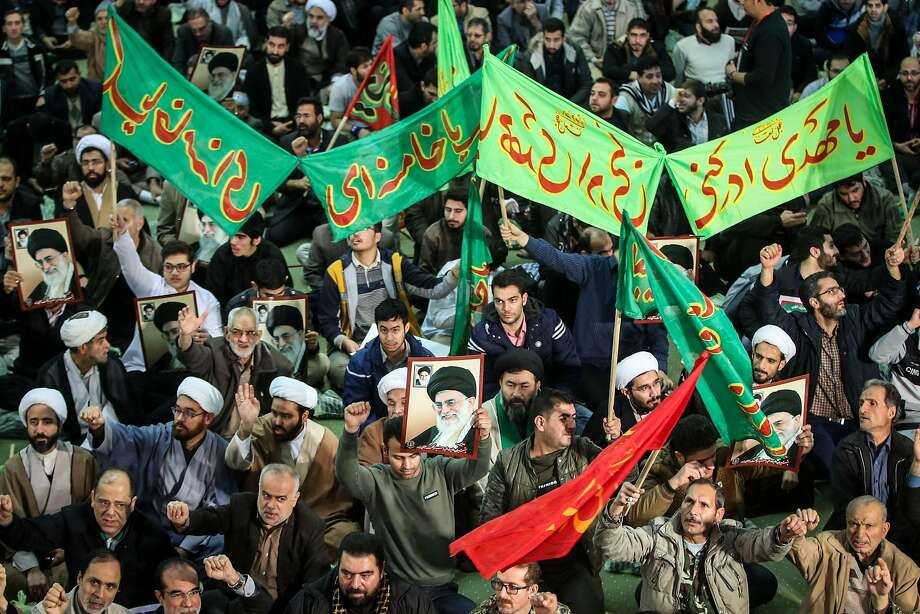 Iranians chant slogans as they march in support of the government near in the capital Tehran. Photo: HAMED MALEKPOUR, AFP/Getty Images