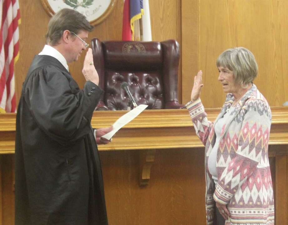 San Jacinto County Judge John Lovett (left) swears in Dianne Griffiths (right) as the appointed County Tax Collector-Assessor on Dec. 4, 2017. Lovett is not running for reelection and is instead running in the Pct. 1 Justice of the Peace election. Photo: Jacob McAdams