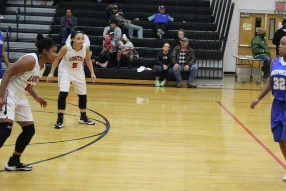 Shepherd Lady Pirate Kasi Wyatt (32) looks for an opening to make a pass to get the ball past the Kountze Lionettes during their game at the Woodville ISD basketball tournament on Dec. 28.