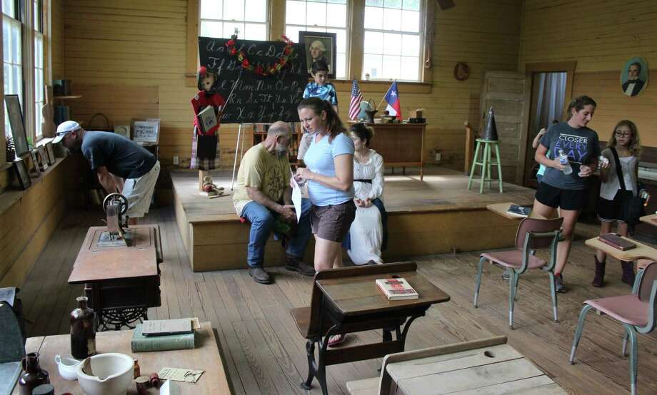 Visitors to Old Town Coldspring check out the inside of the Rosenwald School. Photo: Jacob McAdams