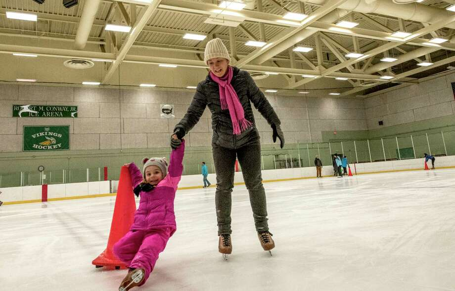 Maya Alperson, 4, with some help from her mother, Leah Johnson, of North Greenish, enjoy a public skate at the Conway Ice Rink at Hudson Valley Community College's Conway Rink on Tuesday, Dec 26, 2017, in Troy, N.Y.  (Skip Dickstein/ Times Union) Photo: SKIP DICKSTEIN / 20041976A