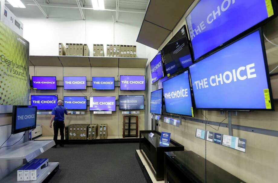 This Tuesday, May 23, 2017, photo shows televisions on display at a Best Buy in Cary, N.C. If you are shopping for a new flat-screen TV or dresser for the baby's room this holiday season, factoring in safety concerns can save you some trouble. Federal safety regulators recommend anchoring TVs and dressers to the wall to prevent them from tipping over, especially with small children around. Planning for that could influence which product you choose and where to put it in your home. (AP Photo/Gerry Broome) Photo: Gerry Broome / Copyright 2017 The Associated Press. All rights reserved.