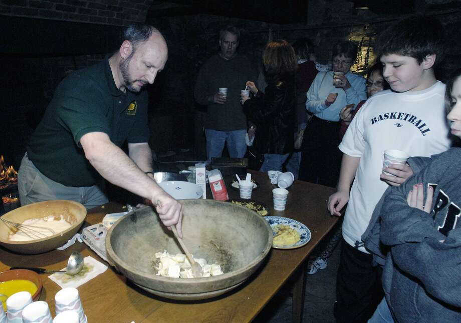 Times Union Photo by James Goolsby-Jan. 6 2007-(LEFT-Joe Gramaldi, volunteer for the Crailo State Historic Site. Makes a pound cake while heartside cooking. As part of the Annual Twelfth Night Celebration at the Crailo State Historic Site in Rensselaer. Photo: JAMES GOOLSBY / ALBANY TIMES UNION