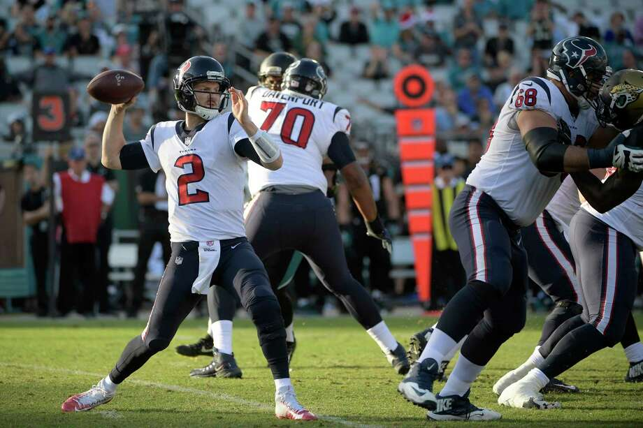 Houston Texans quarterback T.J. Yates (2) throws a pass as offensive tackle Breno Giacomini (68) blocks Jacksonville Jaguars defensive end Lerentee McCray, right, during the second half of an NFL football game Sunday, Dec. 17, 2017, in Jacksonville, Fla. The Jaguars won 45-7. (AP Photo/Phelan M. Ebenhack) Photo: Phelan M. Ebenhack, FRE / FR121174 AP