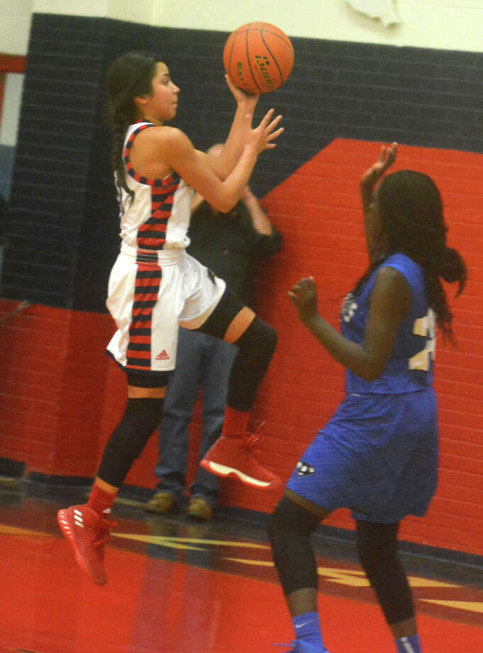 Plainview's Kristan Rincon drives to the basket against Palo Duro this season. The senior is the latest in a long line of talented point guards for the Lady Bulldogs. Photo: Skip Leon/Plainview Herald