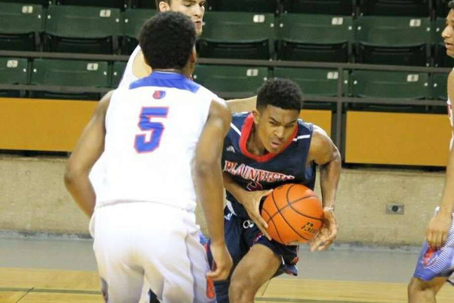 Plainview's Ryan Jackson clutches the basketball as he is pressured by San Angelo Central defenders during a game at the Byron Johnston Holiday Classic in Midland Friday. The Bulldogs were winless in four games at the tournament. Photo: Carmen Ortega/Plainview Herald