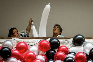 Norma Hernandez, 55, and her husband Jose Luis Hernandez, 56, inflate balloons, Saturday, Dec. 30, 2017, in Houston for the yearly Hyatt Regency Houston New Year's Eve Party for the 23rd year in a row. This year is the 40th year the hotel has been celebrating the New Year. ( Marie D. De Jesus / Houston Chronicle )