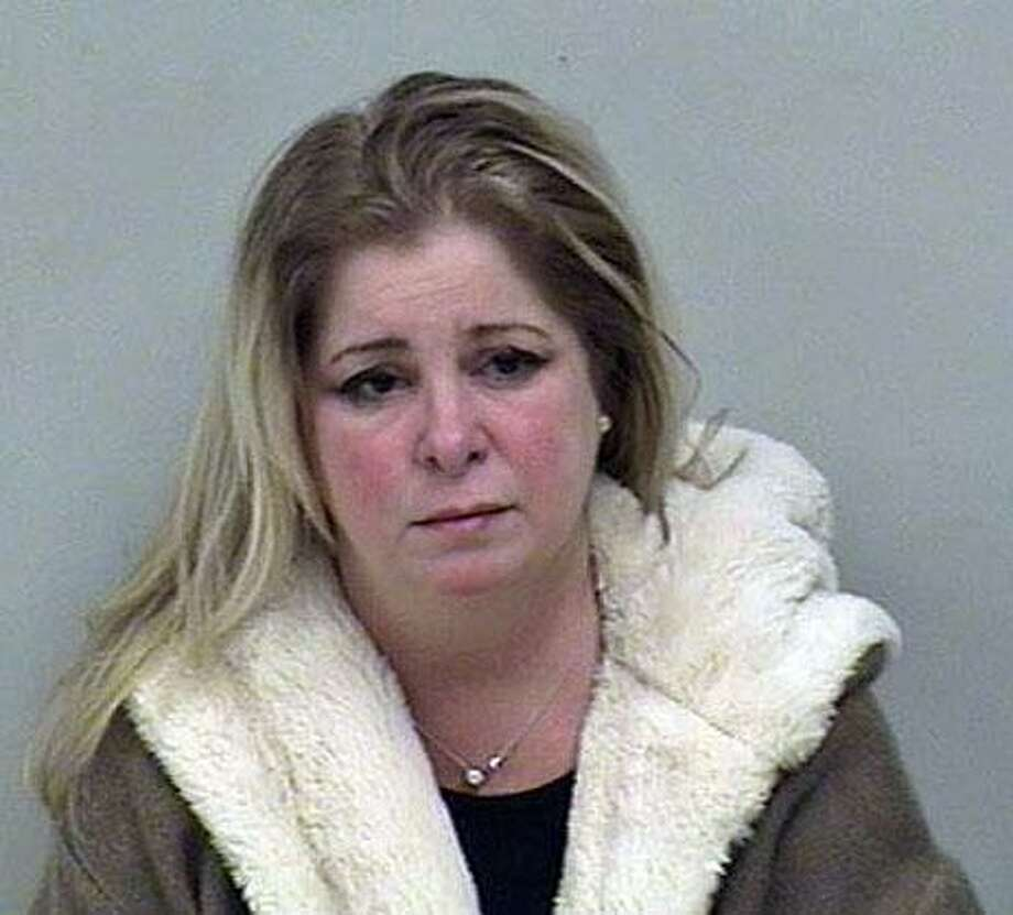 Police charged Gina Heckel, 49, of Fairfield, Conn., with driving under the influence of alcohol/drugs, driving the wrong way on a highway, possession of narcotics and narcotics possession in its original container. Photo: Contributed Photo / Weston Police Department / Contributed Photo / Connecticut Post Contributed