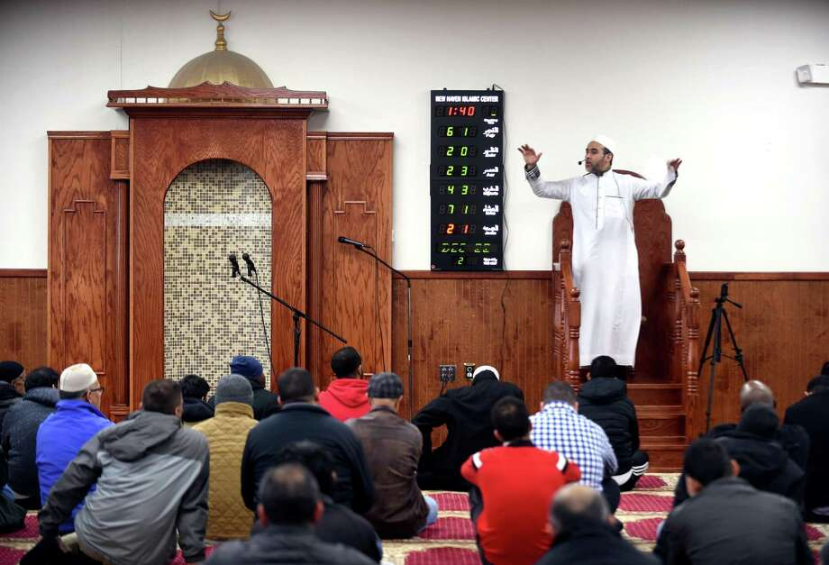 Imam Bachir Djehiche delivers a sermon before a Friday prayer service at the New Haven Islamic Center in Orange on December 22, 2017. Photo: Arnold Gold / Hearst Connecticut Media / New Haven Register